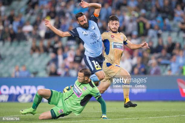 Alex Brosque of the Sydney FC challenges Jets Ivan Vujica and goalkeeper Jack Duncan for the ball during the round seven ALeague match between Sydney...