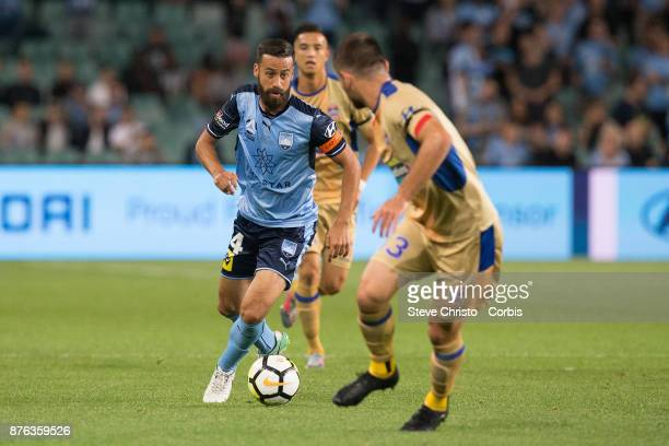 Alex Brosque of the Sydney FC is tackled by Jets Steven Ugarkovic during the round seven ALeague match between Sydney FC and Newcastle Jets at...