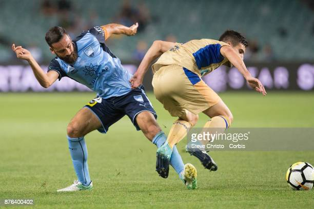 Alex Brosque of the Sydney FC tackles Jets Steven Ugarkovic during the round seven ALeague match between Sydney FC and Newcastle Jets at Allianz...