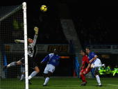 Alex Brown of Droylsden scores past Trevor Carson of Chesterfield during the FA Cup Second Round Match between Chesterfield and Droylsden at The...