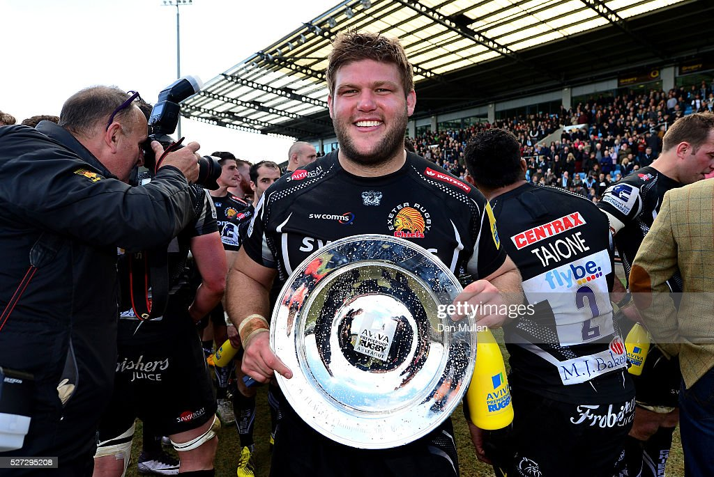 Alex Brown of Exeter Braves celebrates with the trophy following victory during the Aviva Premiership A League Final between Exeter Braves and...