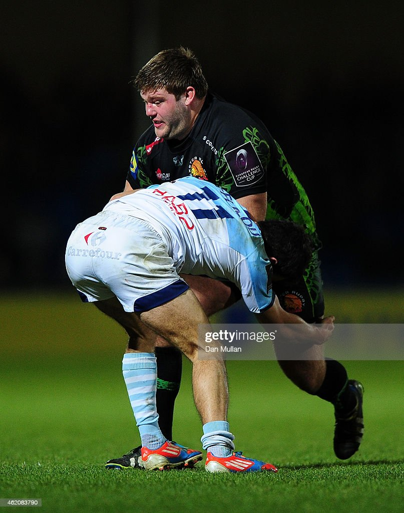 Alex Brown of Exeter Chiefs is tackled by Pierre Sayerse of Bayonne during the European Rugby Challenge Cup match between Exeter Chiefs and Bayonne...