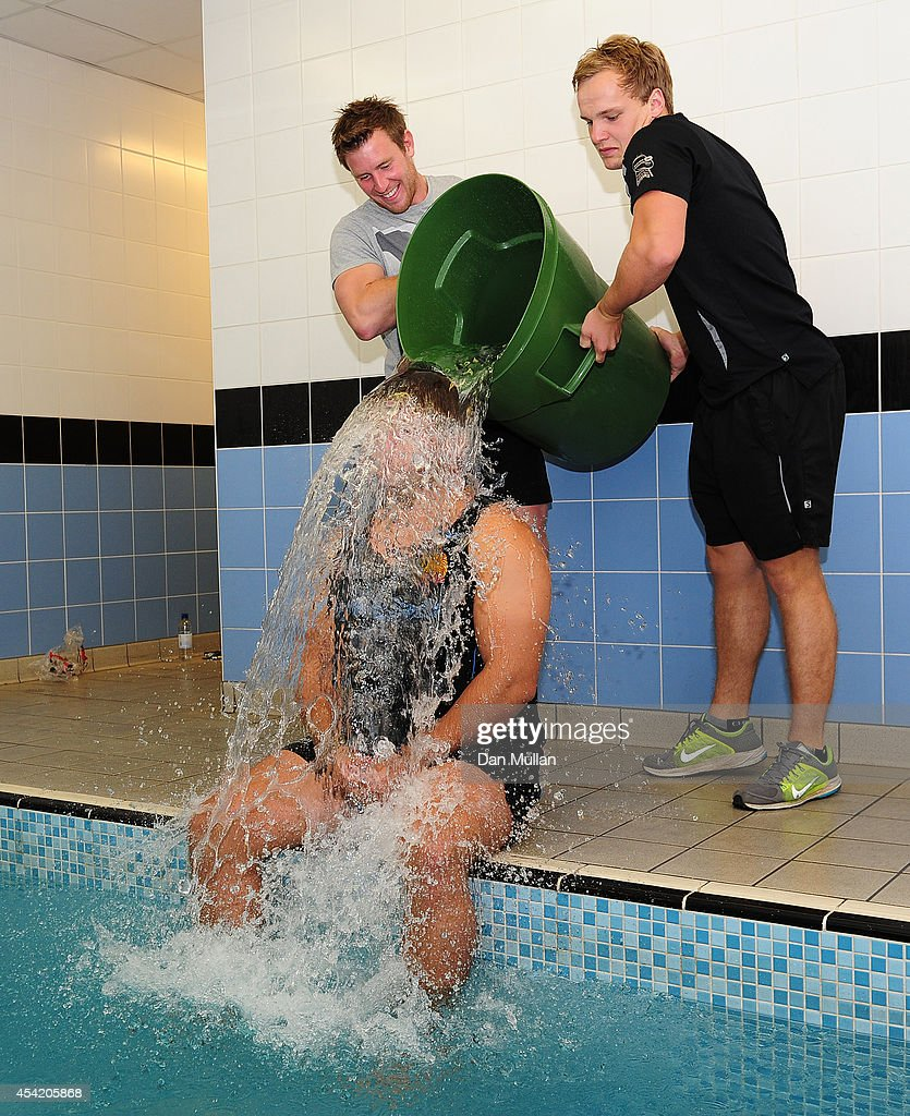 Alex Brown of Exeter Chiefs takes part in the Ice Bucket Challenge helped by Will Chudley and Stuart Townsend of Exeter Chiefs during the photocall...