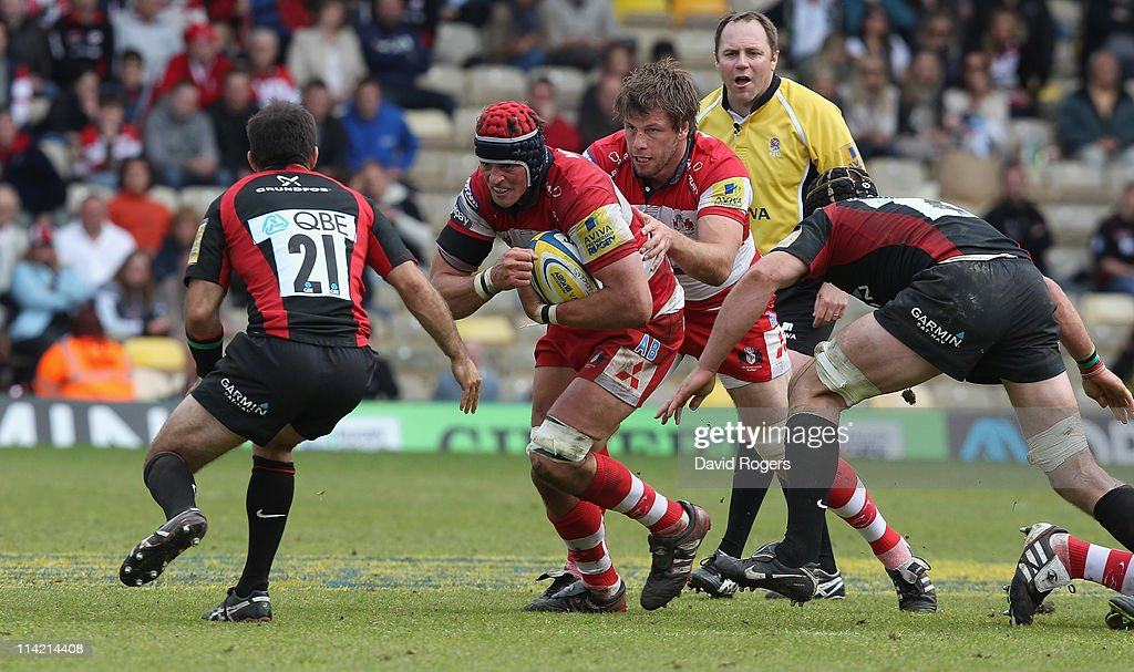 Alex Brown of Gloucester charges upfield during the Aviva Premiership semi final match between Saracens and Gloucester at Vicarage Road on May 15...