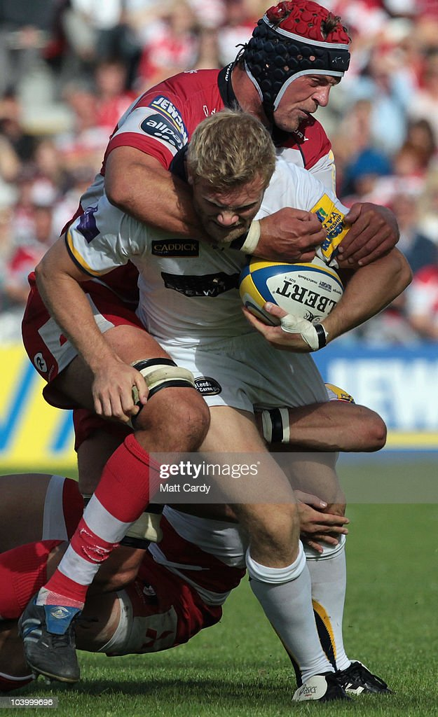Alex Brown of Gloucester Rugby challenges Michael Stephenson of Leeds Carnegie during the Guinness Premiership match between Gloucester Rugby and...