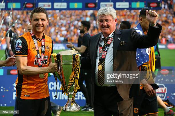 Alex Bruce of Hull City and his father Steve Bruce manager of Hull City celebrate with the trophy after the Sky Bet Championship Play Off Final match...