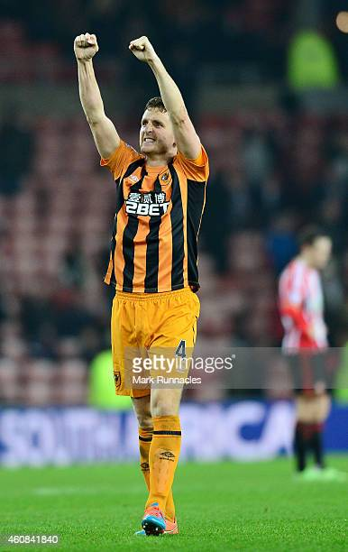 Alex Bruce of Hull City celebrates his team's 31 victory during the Barclays Premier League match between Sunderland and Hull City at the Stadium of...