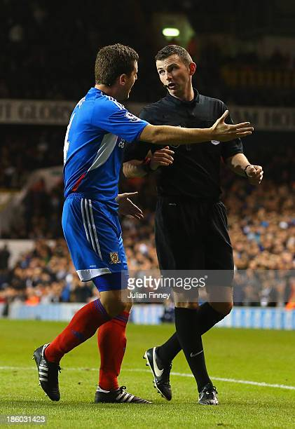 Alex Bruce of Hull City complains to Referee Michael Oliver after he awarded Spurs a penalty during the Barclays Premier League match between...
