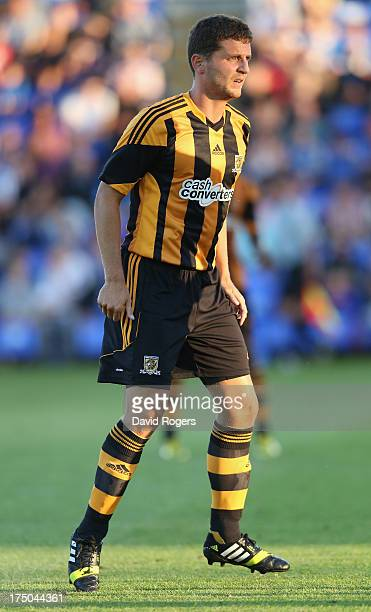 Alex Bruce of Hull City looks on during the pre season friendly match between Peterborough United and Hull City at London Road Stadium on July 29...