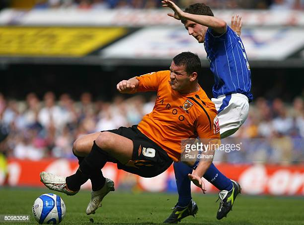 Alex Bruce of Ipswich Town battles for the ball with Dean Windass of Hull City during the CocaCola Championship match between Ipswich Town and Hull...