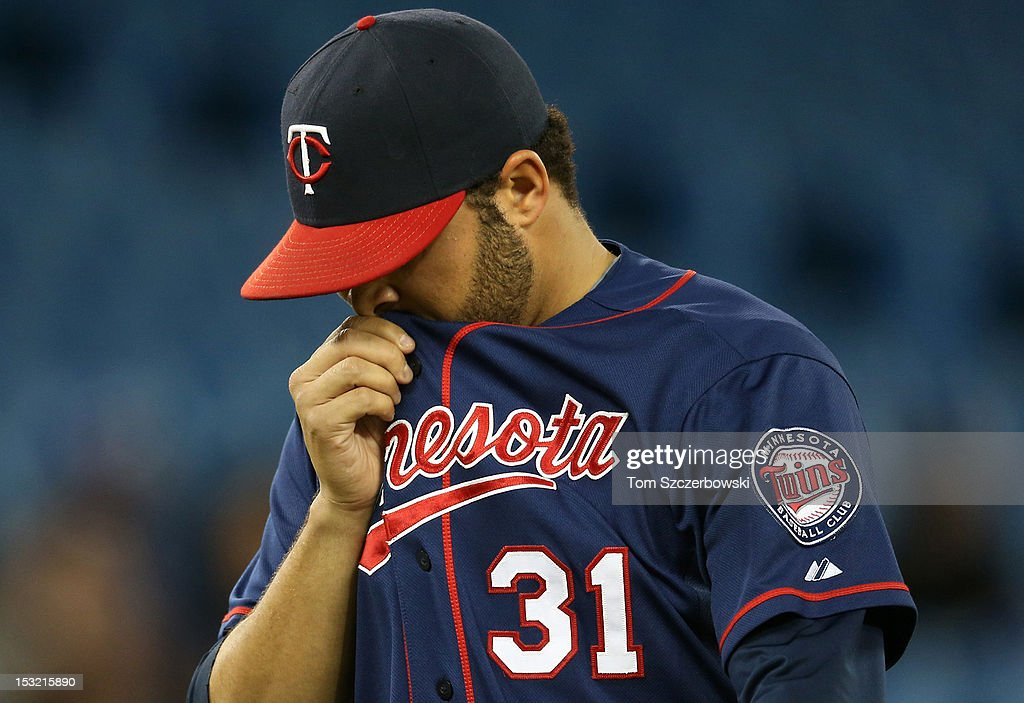 <a gi-track='captionPersonalityLinkClicked' href=/galleries/search?phrase=Alex+Burnett&family=editorial&specificpeople=6826635 ng-click='$event.stopPropagation()'>Alex Burnett</a> #31 of the Minnesota Twins walks off the mound after giving up a run during MLB game action against the Toronto Blue Jays on October 1, 2012 at Rogers Centre in Toronto, Ontario, Canada.