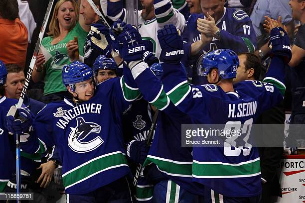 Alex Burrows and Henrik Sedin of the Vancouver Canucks celebrate after a goal in the third period during Game Five of the 2011 NHL Stanley Cup Final...