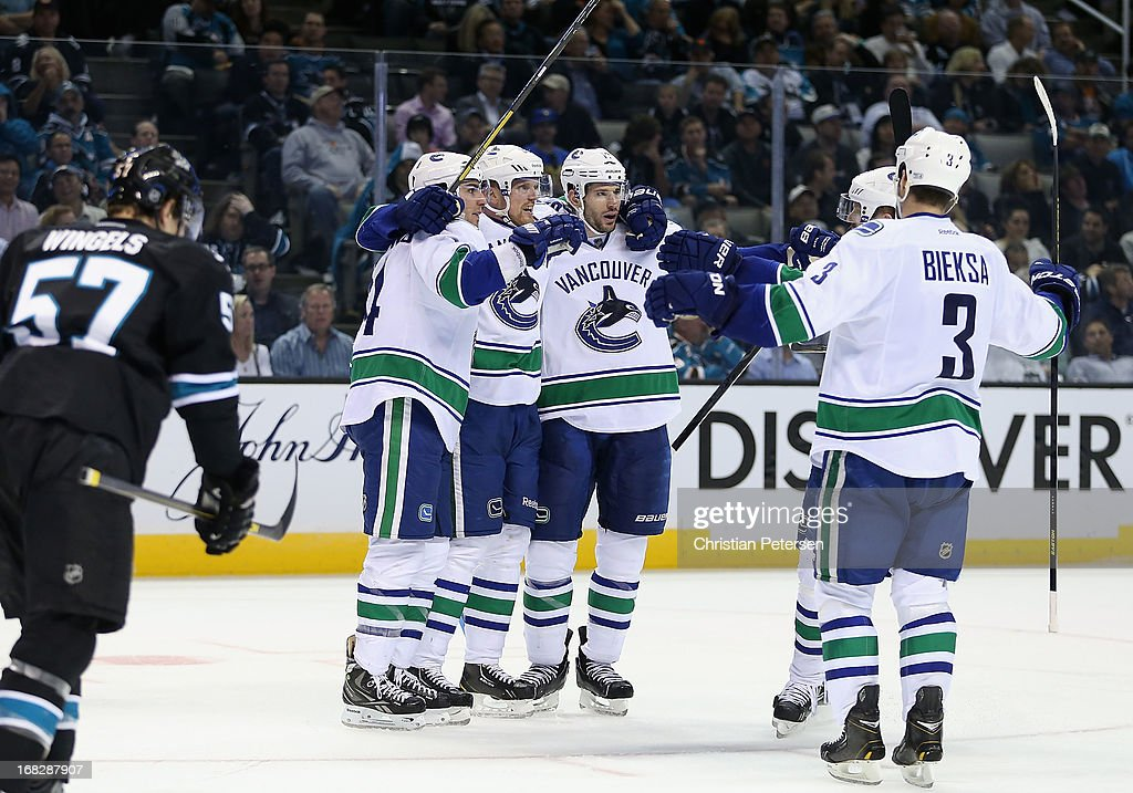 Alex Burrows #14, Henrik Sedin #33, Ryan Kesler #17, Daniel Sedin #22 and Kevin Bieksa #3 of the Vancouver Canucks celebrate after Burrows scored a third period goal against the San Jose Sharks in Game Four of the Western Conference Quarterfinals during the 2013 NHL Stanley Cup Playoffs at HP Pavilion on May 7, 2013 in San Jose, California.