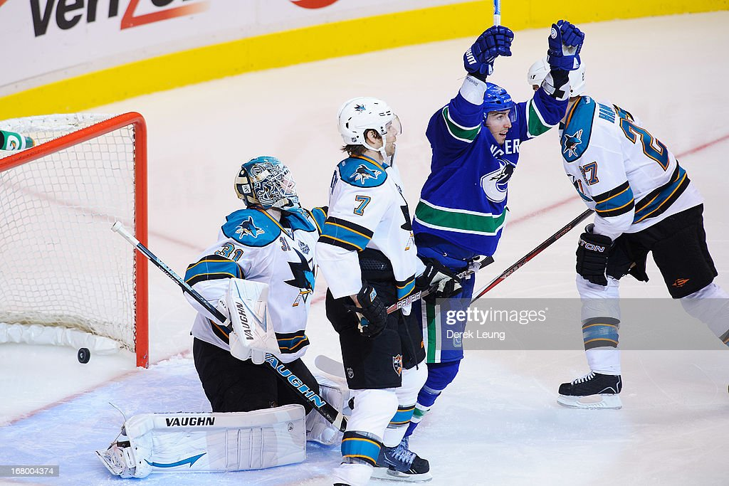 Alex Burrows #14 of the Vancouver Canucks celebrates the goal of Ryan Kesler #17 (not pictured) against <a gi-track='captionPersonalityLinkClicked' href=/galleries/search?phrase=Antti+Niemi&family=editorial&specificpeople=213913 ng-click='$event.stopPropagation()'>Antti Niemi</a> #31 of the San Jose Sharks in Game Two of the Western Conference Quarterfinals during the 2013 NHL Stanley Cup Playoffs at Rogers Arena on May 3, 2013 in Vancouver, British Columbia, Canada.