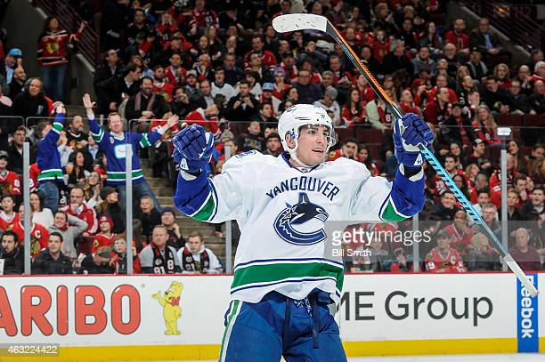 Alex Burrows of the Vancouver Canucks reacts after the Canucks scored against the Chicago Blackhawks in the third period during the NHL game at the...