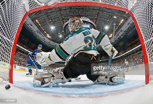 Alex Burrows of the Vancouver Canucks scores on Antti Niemi of the San Jose Sharks in Game Five of the Western Conference Finals during the 2011 NHL...