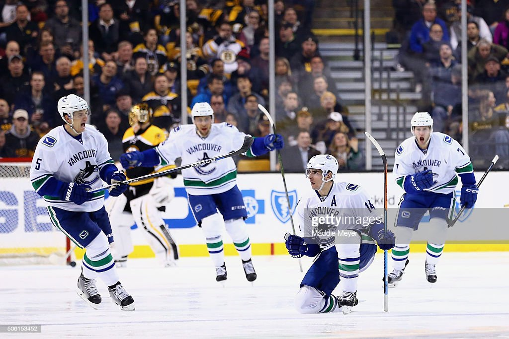 Alex Burrows #14 of the Vancouver Canucks, second from right, celebrates wiht Luca Sbisa #5 and Linden Vey #7 after scoring against the Boston Bruins during the third period at TD Garden on January 21, 2016 in Boston, Massachusetts. The Canucks defeat the Bruins 4-2.