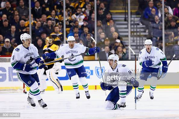 Alex Burrows of the Vancouver Canucks second from right celebrates wiht Luca Sbisa and Linden Vey after scoring against the Boston Bruins during the...