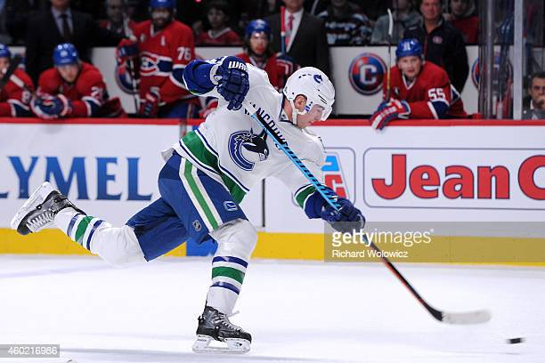 Alex Burrows of the Vancouver Canucks shoots the puck during the NHL game against the Montreal Canadiens at the Bell Centre on December 9 2014 in...