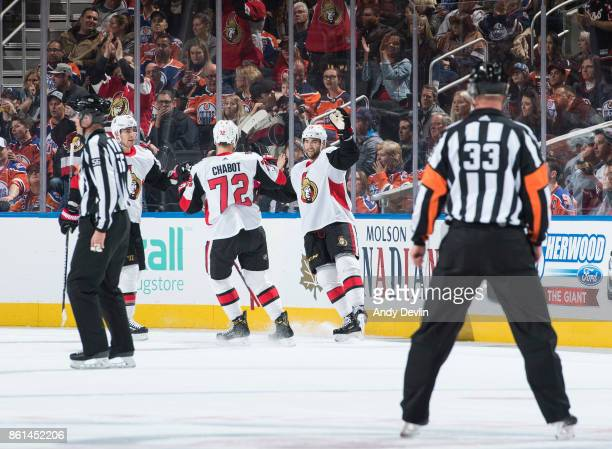 Alex Burrows Thomas Chabot and Derick Brassard of the Ottawa Senators celebrate a goal against the Edmonton Oilers on October 14 2017 at Rogers Place...