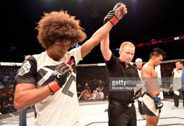 Alex Caceres reacts after his TKO victory over Rolando Dy of the Philippines in their featherweight bout during the UFC Fight Night event at the...