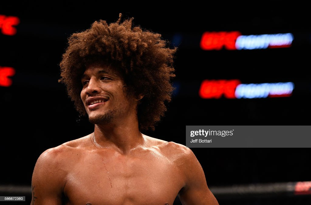 Alex Caceres waits to hear the judges decision after facing Yair Rodriguez of Mexico in their featherweight bout during the UFC Fight Night event at Vivint Smart Home Arena on August 6, 2016 in Salt Lake City, Utah.