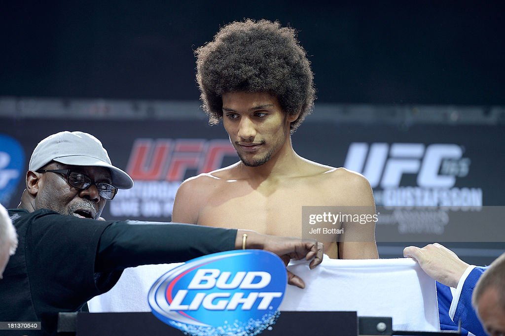 Alex Caceres weighs in during the UFC 165 weigh-in at the Maple Leaf Square on September 20, 2013 in Toronto, Ontario, Canada.