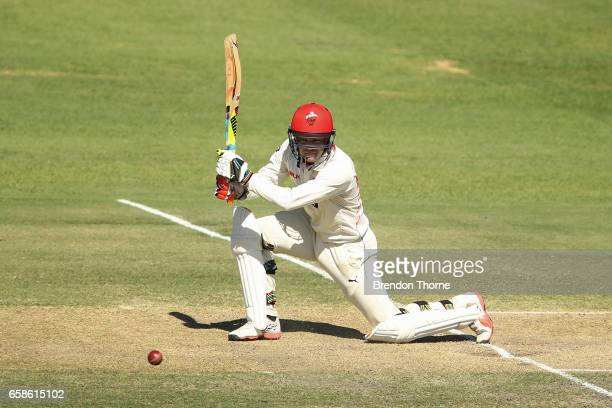 Alex Carey of the Redbacks plays a cover drive during the Sheffield Shield final between Victoria and South Australia on March 28 2017 in Alice...