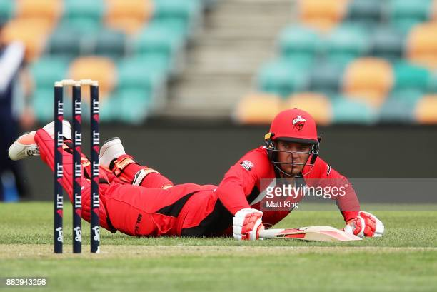 Alex Carey of the Redbacks slides in to avoid a runout during the JLT One Day Cup match between South Australia and Victoria at Blundstone Arena on...