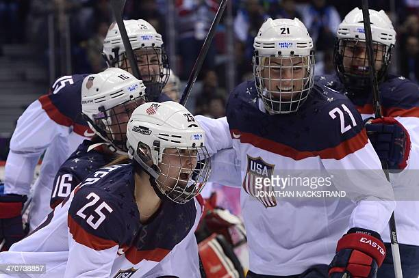 US Alex Carpenter celebrates with teammates after scoring during the Women's Ice Hockey Gold Medal Game between Canada and USA at the Bolshoy Ice...
