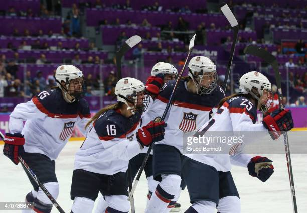 Alex Carpenter of the United States celebrates scoring a thirdperiod goal against Canada with teammates Hilary Knight Kelli Stack and Anne Schleper...