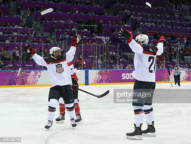 Alex Carpenter of the United States celebrates scoring a thirdperiod goal against Canada with teammate Hilary Knight during the Ice Hockey Women's...