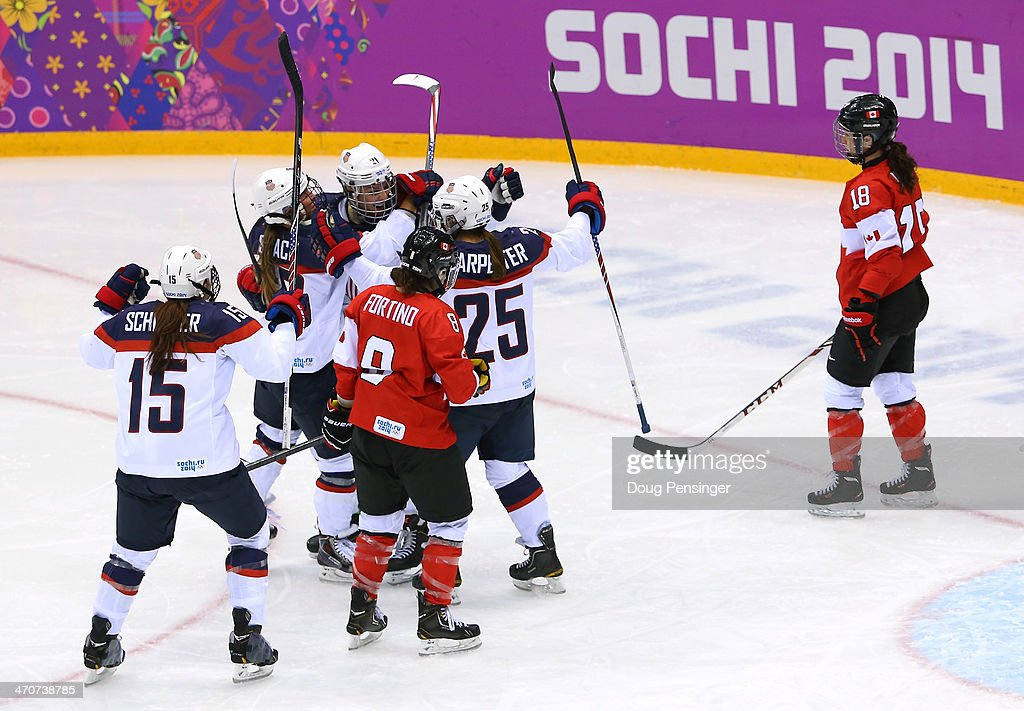Alex Carpenter #25 of the United States celebrates scoring a third-period goal against Canada with teammates Hilary Knight #21, <a gi-track='captionPersonalityLinkClicked' href=/galleries/search?phrase=Kelli+Stack&family=editorial&specificpeople=6214354 ng-click='$event.stopPropagation()'>Kelli Stack</a> #16 and <a gi-track='captionPersonalityLinkClicked' href=/galleries/search?phrase=Anne+Schleper&family=editorial&specificpeople=9030350 ng-click='$event.stopPropagation()'>Anne Schleper</a> #15 during the Ice Hockey Women's Gold Medal Game on day 13 of the Sochi 2014 Winter Olympics at Bolshoy Ice Dome on February 20, 2014 in Sochi, Russia.
