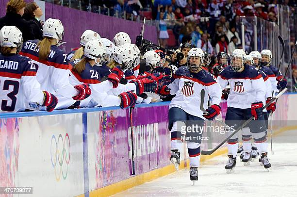 Alex Carpenter of the United States celebrates scoring a thirdperiod goal against Canada with teammates during the Ice Hockey Women's Gold Medal Game...