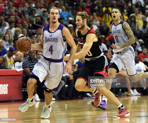 Alex Caruso of the Los Angeles Lakers drives ahead of Jake Layman the Portland Trail Blazers as Kyle Kuzma of the Lakers trails the play during the...