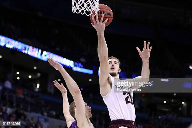Alex Caruso of the Texas AM Aggies makes the basket and draws the foul late in the second half against Paul Jesperson of the Northern Iowa Panthers...