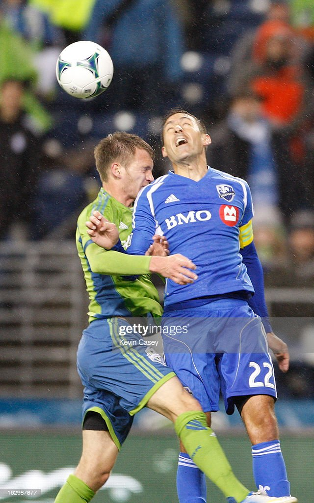 Alex Caskey #14, of Seattle Sounders goes for a header against <a gi-track='captionPersonalityLinkClicked' href=/galleries/search?phrase=Davy+Arnaud&family=editorial&specificpeople=2291388 ng-click='$event.stopPropagation()'>Davy Arnaud</a> #22, of Montreal Impact, in the second half against Seattle Sounders at CenturyLink Field on March 2, 2013 in Seattle, Washington.