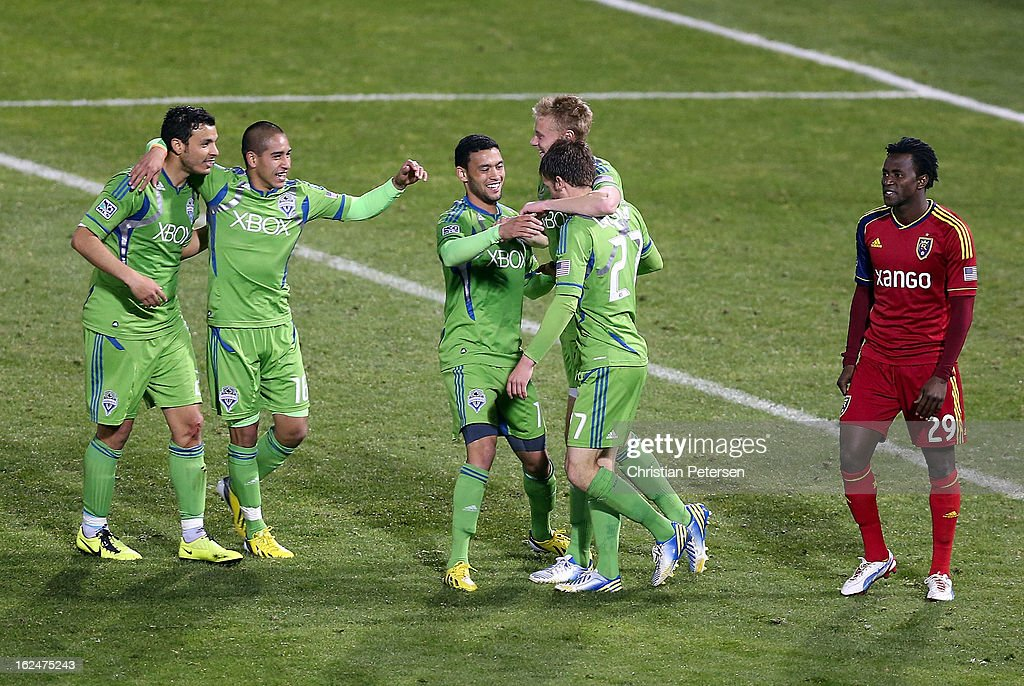 Alex Caskey #27 of the Seattle Sounders is congratulated by (L-R) Servando Carrasco #23, David Estrada #16, Lamar Neagle #14 and Andy Rose #25 after scoring a second half goal against Real Salt Lake during FC Tucson Desert Diamond Cup Championship match at Kino Sports Complex on February 23, 2013 in Tucson, Arizona. The Sounders defeated Real Salt Lake 1-0 to win the Championship.