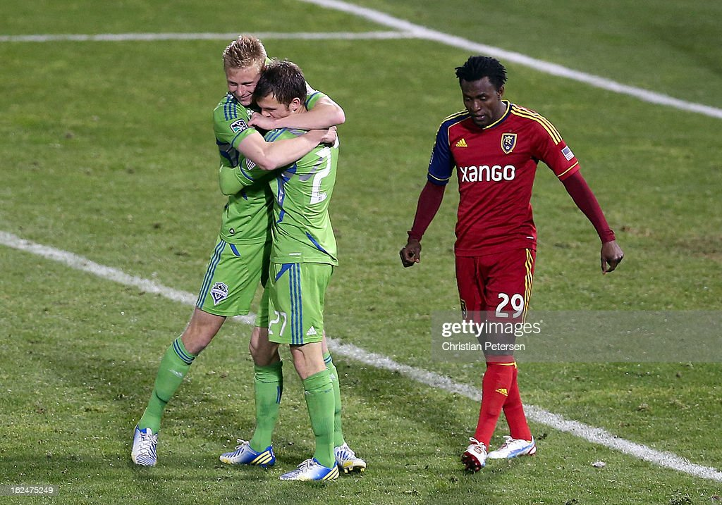 Alex Caskey #27 of the Seattle Sounders is hugged by Andy Rose #25 after scoring a second half goal past Kenny Mansally #29 of Real Salt Lake during FC Tucson Desert Diamond Cup Championship match at Kino Sports Complex on February 23, 2013 in Tucson, Arizona. The Sounders defeated Real Salt Lake 1-0 to win the Championship.
