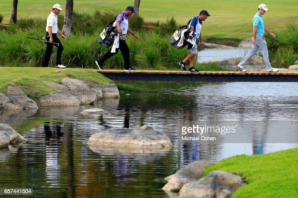 Alex Cejka of Germany and Nick Taylor of Canada walk up to the 13th green during the second round of the Puerto Rico Open at Coco Beach on March 24...