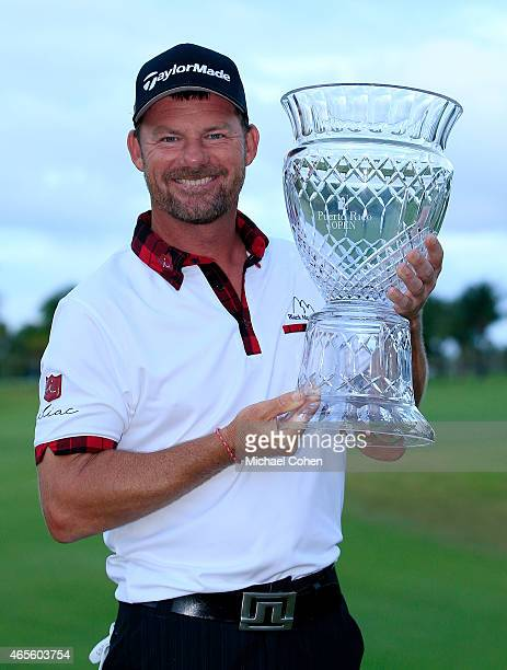 Alex Cejka of Germany celebrates with the trophy after winning the playoff during the final round of the Puerto Rico Open presented by Banco Popular...