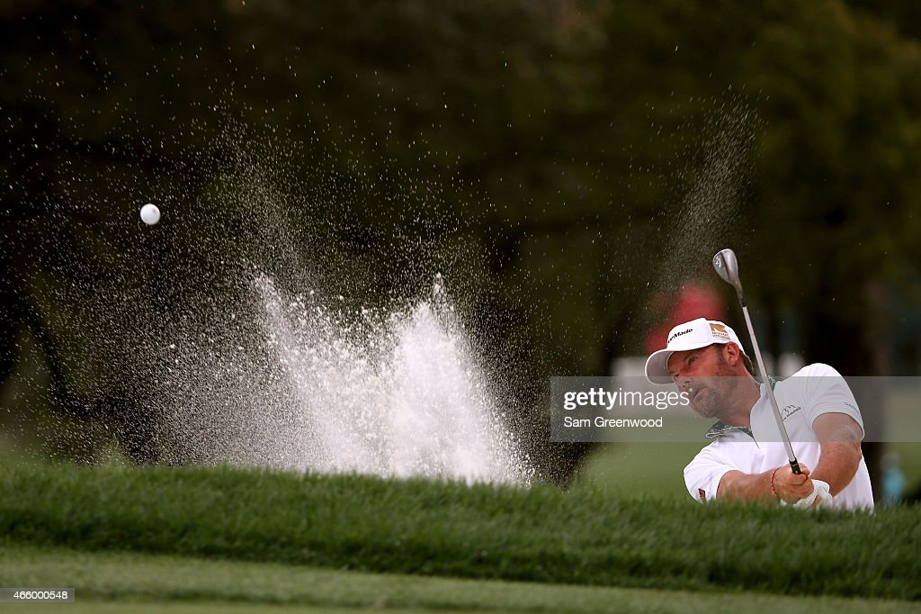 Alex Cejka of Germany hits out of a bunker on the 18th hole during the first round of the Valspar Championship at Innisbrook Resort Copperhead Course...