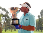 Alex Cejka of Germany kisses the winner's trophy after the final round of the Pacific Rubiales Colombia Championship Presented by Claro at Country...