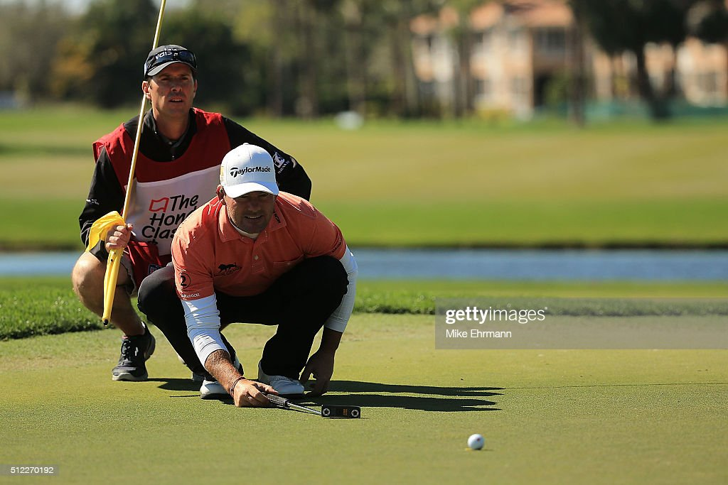 Alex Cejka of Germany lines up a putt on the eighth green during the first round of the Honda Classic at PGA National Resort Spa Champions Course on...