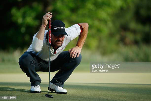 Alex Cejka of Germany lines up a putt on the ninth hole during the first round of the Shell Houston Open at the Golf Club of Houston on April 2 2015...