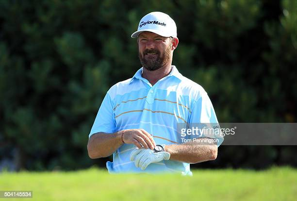 Alex Cejka of Germany plays his shot from the first tee during round two of the Hyundai Tournament of Champions at the Plantation Course at Kapalua...