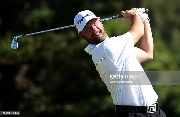 Alex Cejka of Germany plays his shot from the second tee during round one of the Hyundai Tournament of Champions at the Plantation Course at Kapalua...