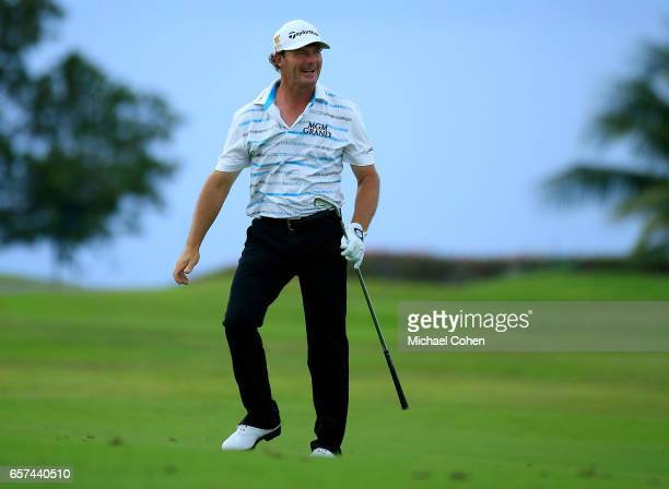 Alex Cejka of Germany reacts after playing his second shot on the 13th hole during the second round of the Puerto Rico Open at Coco Beach on March 24...