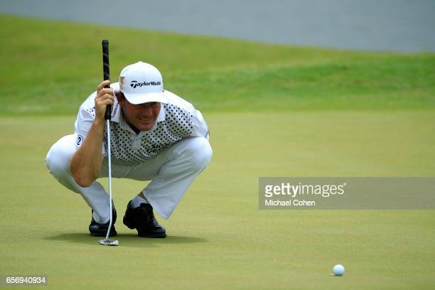 Alex Cejka of Germany reads his birdie putt on the eighth green during the first round of the Puerto Rico Open at Coco Beach on March 23 2017 in Rio...