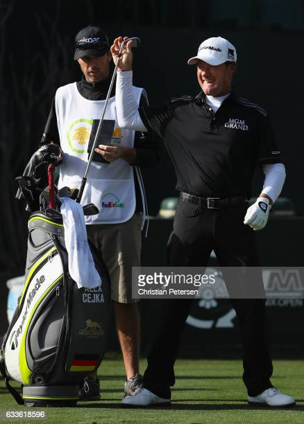 Alex Cejka of Germany takes a club from his bag on the 16th hole during the first round of the Waste Management Phoenix Open at TPC Scottsdale on...